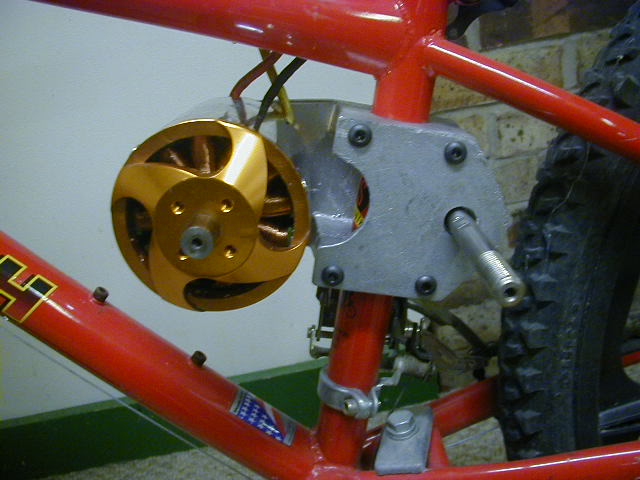 "From E-bike hot-rodder ""Thud"", an 80mm motor with the jackshaft and tube-clamp all in one piece. The belted primary reduction is on the right side."