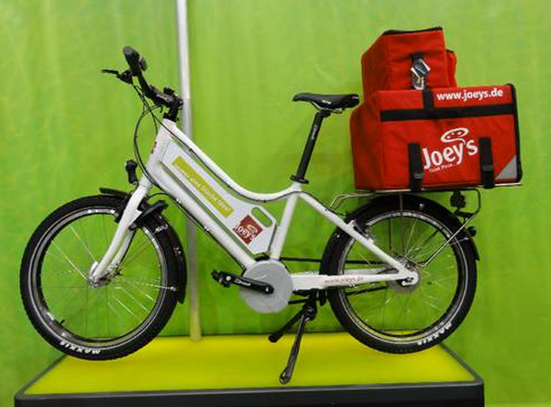 Electric bicycles are being used to deliver pizza in for Motorized bicycle shops near me